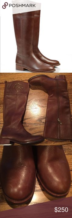 """Tory Burch Kieran Riding Boot Tory Burch must-have riding boot. A classic equestrian shape dressed up with fretwork-inspired gold metal. 1.3"""" stacked heel. Gold-tone logo detail with stud embellishments. Zipper closure. Leather and fabric jacquard lining. Leather sole. Lightly worn. Tory Burch Shoes Heeled Boots"""