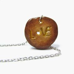 Boho Love necklace, Brown disc pendant with hole, Sculpted eco clay jewelry, Yellow ombre pendant, Rustic message gift for sister nan mum