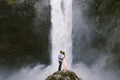 Snoqualmie Falls Seattle Washington engagement photos couple kissing at the bottom of the waterfall - Photo by Jacilyn M  www.jacilynm.com
