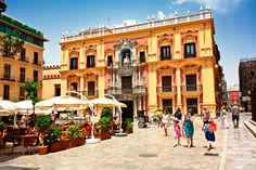 Tourists walk around the historic center of Málaga, Andalusia. Spain