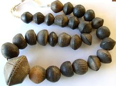 Carved Clay Spindle Whorl Beads - Mali     25-62mm in diameter.
