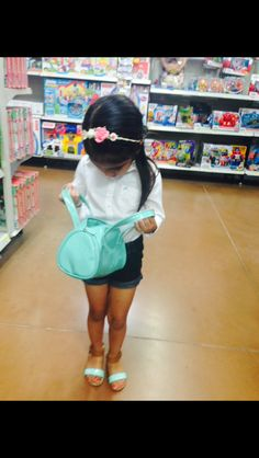 Simple floral headband. White button up. Denim shorts. Cute sandals. Adorable blue purse. Love her toddler fashion.  Kids fashion