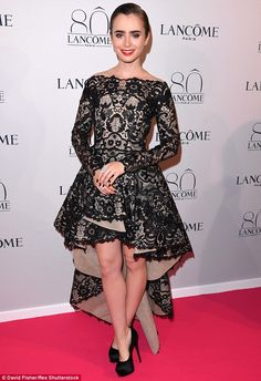 High fashion: Lily Collins wore a stunning black and nude lace gown to theLancome 80th anniversary party in Paris forHaute Couture Fashion Week on Tuesday