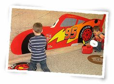 Oh no! McQueen Blew a Tire! Quick help McQueen change his tire so he can get back in the race!---->Hand painted cardboard or plywood. With frozen pizza cardboard tires painted like tires.