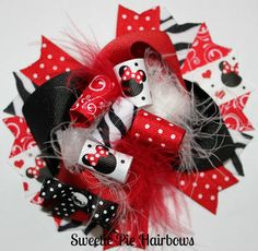Funky Minnie Mouse Hair bow Over the Top Hair Bow Deluxe Boutique Hairbows Funky loopy Red and Black Zebra mouse Bow. $11.99, via Etsy.