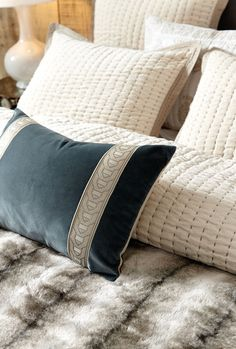 As if velvet pillows couldn't get any more lovely, we've added two chic strips of trim for a more polished look!