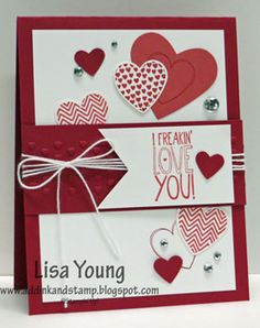 handmade Valentine by Lisa Young ... red and white ... lots of hearts strewn about ... like the sentiment panel with white cord bow and triple wrapping the partly disappears under the banner sentiment ... fabulous card! ... Stampin' Up!