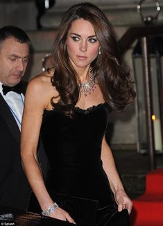 So pretty! Newest Kate pics....Duchess of Cambridge showed off some seriously toned arms this evening in her strapless McQueen dress despite it being cold & damp in London #katemiddleton