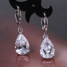 18K White Gold Swarovski Crystal Dangle Earrings 18K white gold filled Swarovski crystal dangle earrings.  Please feel free to ask me any questions you may have, & thank you for taking a look & sharing this listing!  Boutique Jewelry Earrings