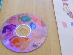 Markers --> water colors! Scribble some colors on an old CD, dip paintbrush in water, then in color, paint paper! Amount of water on brush determines saturation of color.