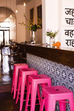 indian canteen restaurant interior with hot pink stools, bright pink, fuchsia, pantone pink yarrow