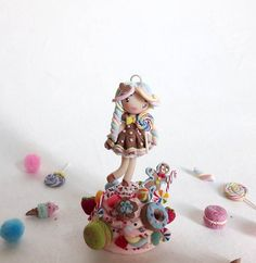 Candy girl in a candy dream!🍭🍦🍰🍬🍮 I hope you like sweets guys!  The stand is different by my usual stands, but I wandered to put all the sweets I made on it to give the idea of a sort of candy town where gingerbread men live! What do you think?😊 It needs just to be glazed. Tomorrow I'll post her sister!💗🍭  .  y...
