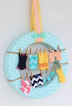 Cutest ever summer wreath! Sew these tiny swimsuits to make your own fun summer clothesline wreath.