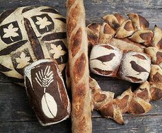 """""""Rain or shine we're [@CarrboroMarket] today with autumn flavors. [#bread]"""" Stenciled loaves by Rob of Chicken Bridge Bakery [@ChickenBridgeBa on Twitter], pinned with permission."""
