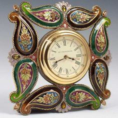 DESCRIPTION: Jay Strongwater Desk Clock features bronze and enamel floral designs with synthetic stones. on Dec 2018 Desk Clock, Clock Table, Sistema Solar, Jay Strongwater, Father Time, Dresser Sets, Antiques Online, Antique Clocks, Vintage Watches