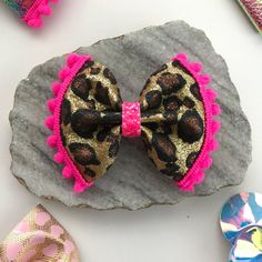 Pink Leopard Glitter Pom Pom, hair bow, hair clip, headband. Available in you choice hair clip: Alligator clip with non-slip grip Alligator with teeth **Ships 3-4 days after payment clears. I ship First Class which takes 3-5 days. If you need it sooner please message me for more