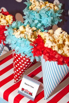 party hats as popcorn cones~clever idea in theme colors