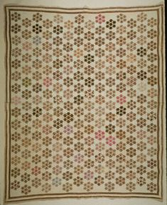 "Seven Stars Quilt, Illinois State Museum; 68x82""; c. 1870; cotton, hand pieced; cream cotton batting in 3 pieces; cotton plain weave binding; thin cotton batting; hand quilted w/ white cotton thread at 7 spi in all over diamond grid; made by Mary Ellen McLain James (1847-1934), m. 1865 IL George W. James who cut all the pieces for this quilt, was disabled Civil War veteran"