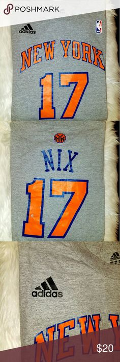 Mens' Adidas New York Nix t-shirt Mens' sports t-shirt. Orange and blue lettering on gray t-shirt. Size 3x. There are some flaws that are pictured in the number 1, and the lettering on the back of the shirt. Adidas Shirts Tees - Short Sleeve