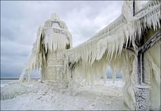 Barely recognizable under a thick coating of ice, the St. Joseph, Michigan outer light, withstands another brutal winter on Lake Michigan. Temperatures dropped near zero, and winds whipped up, causing massive icing on anything near the lake.