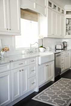 Monika Hibbs from The Doctor's Closet - Gorgeous kitchen with white shaker cabinets accented with ...