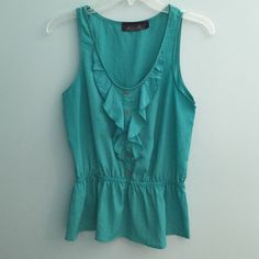 Sleeveless Top Cute turquoise sleeveless top from Francesca's. Gold buttons down the middle for some added detail. Fitted in the middle-- flattering to figure. Look great with pants or shorts or can even tuck into a skirt! Blue Rain Tops