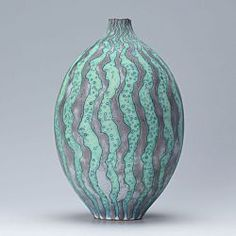 This is a thrown blue stoneware pot by Peter Beard.