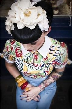 I want this blouse...so...bad. Also, I love this girl! Her hair is amazing and I want her bangles.