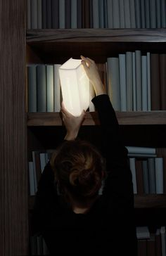 """The """"Enlightenment Book"""" lamp actually provides you with light and literally looks like a magically glowing book!"""