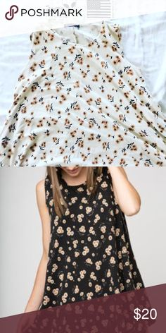 This is Alena Brandy dress The only flaw about this dress is it has a few coffee stain dots. Other than that great condition and super comfortable Brandy Melville Dresses Mini