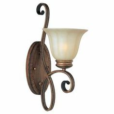 """1-light wall sconce in platinum dusk with a bell-shaped Wilshire glass shade and scrollwork detailing.   Product: Wall sconceConstruction Material: Metal and glassColor: Platinum dusk and creamAccommodates: (1) 100 Watt medium base bulb - not includedDimensions: 17.5"""" H x 7"""" W x 10"""" D"""