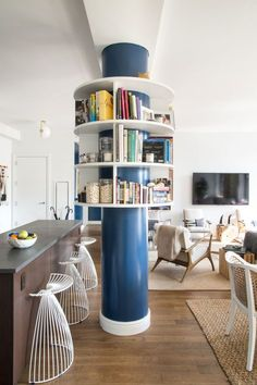 A custom bookshelf built around a structural column makes a unique design statement. Louisa had never crafted anything like it, and it took a team from http://www.spacecarpenter.com// to work it out. - via Home Polish