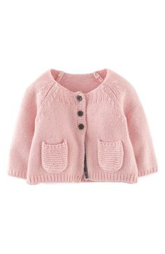 Free shipping and returns on Mini Boden Knit Cardigan (Baby Girls) at Nordstrom.com. Three buttons secure an A-line cardigan accented with contrast velvet inside the placket.