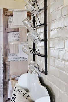 For those who don't have extra counter space to store their mason jars, this wall rack would likely work well.