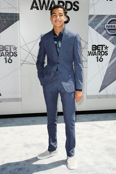 Marcus Scribner is only 16 years old, and he had one of the best (and most stylishly restrained) looks on the BET Awards carpet. The printed shirt. The gray slip-on sneakers. The fit of that suit...Well done, young gun.