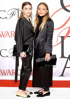 Ashley and Mary-Kate Olsen complemented each other in matching, all-black ensembles and flats—Mary-Kate chose loafers, while Ashley rocked Chanel ballet slippers.