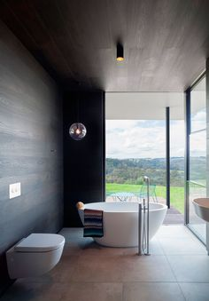 Amazing bathroom created using Tongue n Groove's Raba boards as wall cladding. Installation by Gibraltar Construction. Boards available from http://www.tonguengrooveflooring.com.au