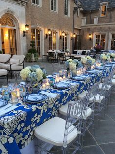 The Enchanted Home:  blue and white melamine dishes, white gardenia candles, mini-Pagoda candles for favors
