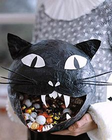 This hissing papier-mache cat has a mouthful of treats.