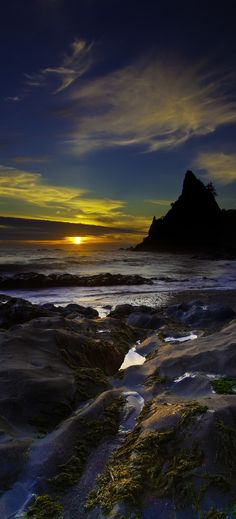 Sunset at Rialto Beach, Washington State.  A vertical panorama composite of two photos.