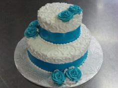 Romantic swirls with ribbon supplied by bride and buttercream roses to match.