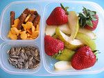 Afternoon snack to nibble on during homework: Fresh fruit, some fishy crackers and pretzel sticks and sunflower seed. Prepare these ahead of time and your kids will know what to reach for after school.