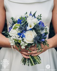 A dainty, rustic bridal bouquet of white avalanche roses, white freesia, white gypsophila, green button chrysanthemums, green bupleurum, white daisy aster, blue gentiana, blue delphinium and blue eryngium. Florissimo - Flowers for weddings, events and businesses in Shropshire and beyond. (Photo: Jonathan Kinnear)