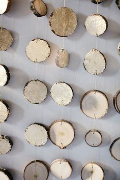 Hanging wood slices make a great backdrop for wedding party photos and add a warm bohemian vibe. Photo by Brian Schindler via Ruffled Blog #BohemianWeddings