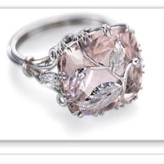 Having the prongs extend into a leaf over the stone is an interesting design. #engagementring #pinkdiamond #custommade