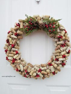 Christmas Wreath made from wine corks and it is our favorite wine cork craft this year.