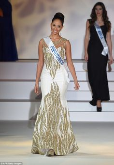 In all her glory: Ms Hernandez wore a floor-length white gown embellished with gold sequin...