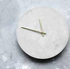 Our Concrete Wall Clock is a rather striking timepiece.Its bold appearance in concrete with brass arms make it ideal for hanging in the kitchen or keeping on eye on the time in the home office or study. This grey concrete clock is very understated, it's the design simplicity which meant that we just had to add it to the All Things Brighton Beautiful collection. Suitable for indoor use only.100% concrete.Dia28cm