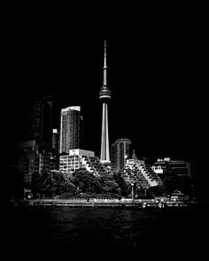 https://flic.kr/p/Ftgc8x | CN Tower From Bathurst Quay Toronto Canada | City of Toronto skyline with the CN Tower front and center from Bathurst Quay at the western end of Harbourfront near Ireland Park. Original photography from 2013 using a Canon EOS 60D body with a Sigma 17-70mm f2.8 DC Macro OS lens. Reprocessed in 2016 using Silver EFEX Pro as a Lightroom plugin for the Black and White conversion. Shameless Self Promotion: Website | Facebook | Twitter Prints: Fin...