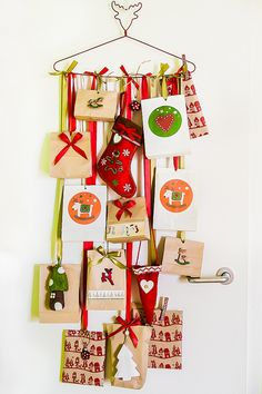 attach cards with clothespins and hang from string on a hanger
